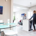 couple standing in spacious townhome kitchen