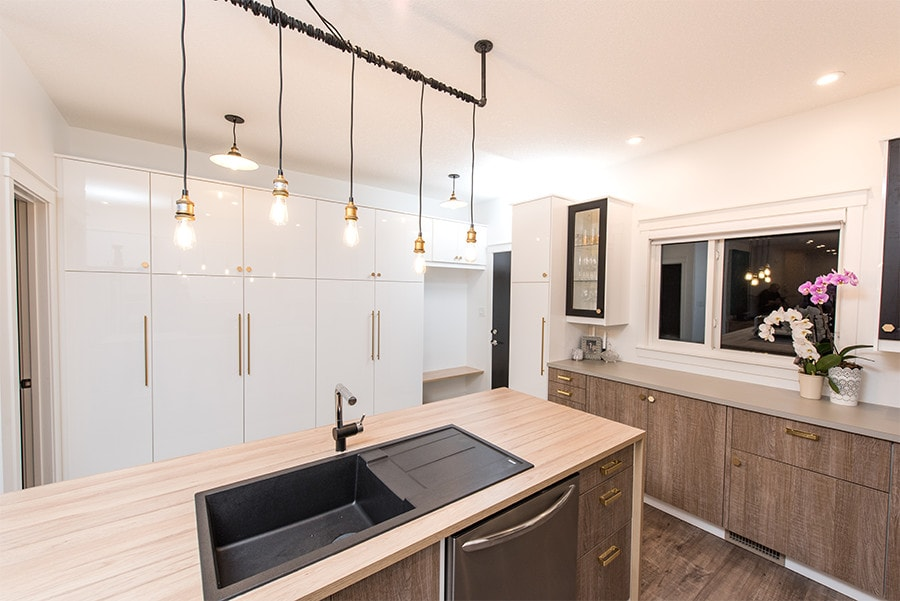 Modern kitchen featuring LED lighting and unique fixtures