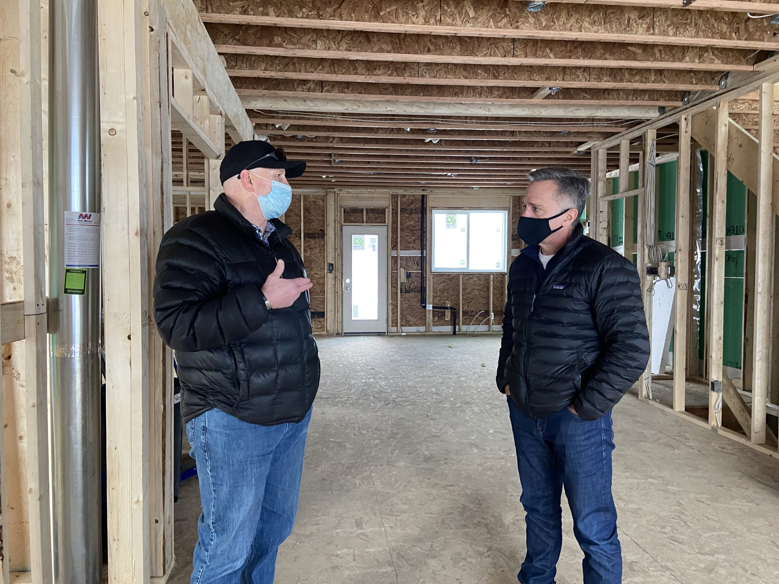 MP_James_Cumming_discussing_infill_at_build_site